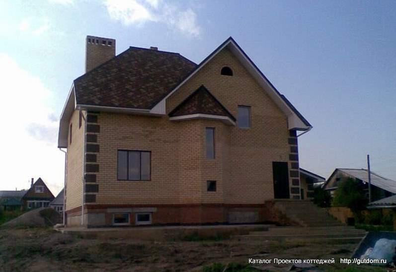 построенный двухэтажный коттедж